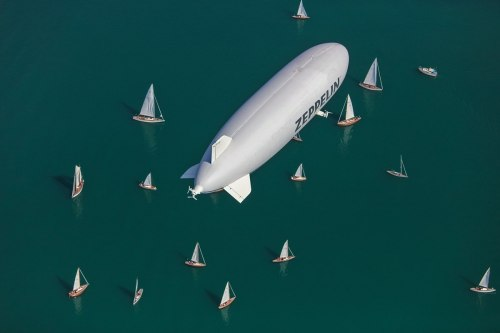 The Zeppelin NT floats over the picturesque Lake Constance with its many sailing boats.